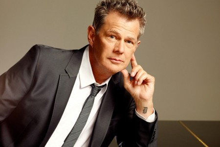 An image of David Foster in a suit and a tie.