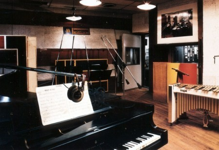 An old image of the Motown recording studio in Detroit with a piano in the front of the picture.
