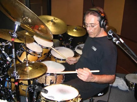 An image of Vinnie Colaiuta on a drumset as one of the Musical Influences and Inspirations