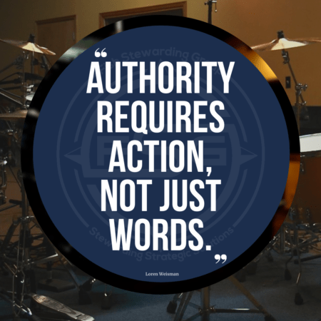 An image of a drum set in the background with a quote on a blue circle in the front that reads Authority requires action, not just words.