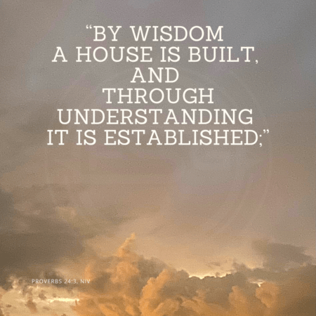 "A quote graphic with a background a dark tan sky with clouds on the bottom. In upper center is an FSG logo watermark and a quote in white text that is credited to Proverbs 24:3 NIV in a small font on the bottom and in the upper center reads, ""By wisdom a house is built, and through understanding it is established;"" from the Strategic messaging and optics quotes blog."