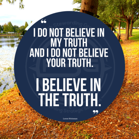 A quote graphic with a lake to the left side and a brown dirt embankment leading down to it with trees and sky in the background and a blue circle in the center with a white border around it with quote text that reads I do not believe in my truth and I do not believe in your truth. I believe in the truth.